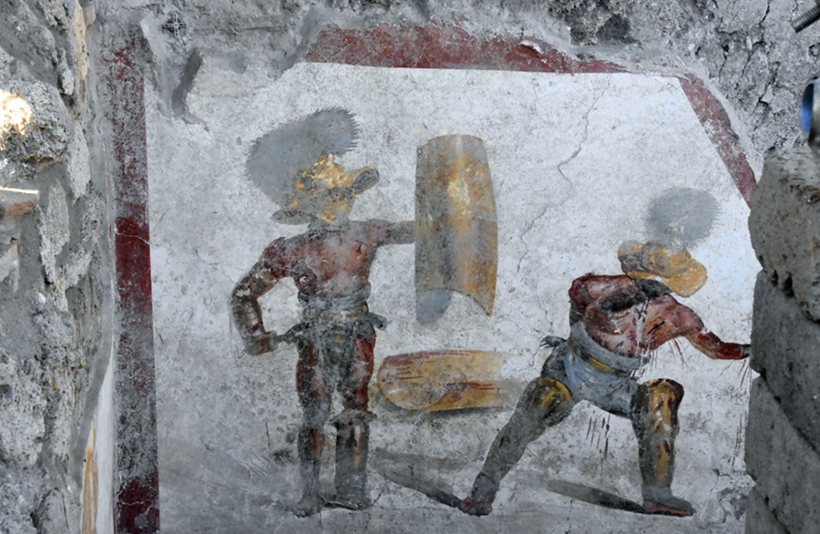 A Pompei il meraviglioso affresco 'splatter' dei gladiatori